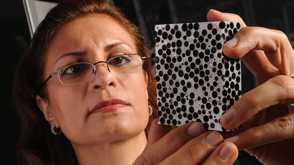Afsaneh Rabiei examines a sample of composite metal foam.