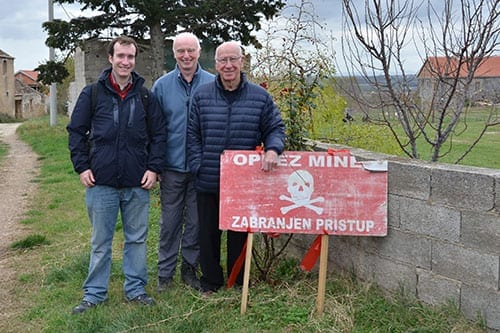 (From left) Dr Oliver Payton and Dr John Day with Sir Bobby Charlton on a visit to mine clearance operations in Croatia
