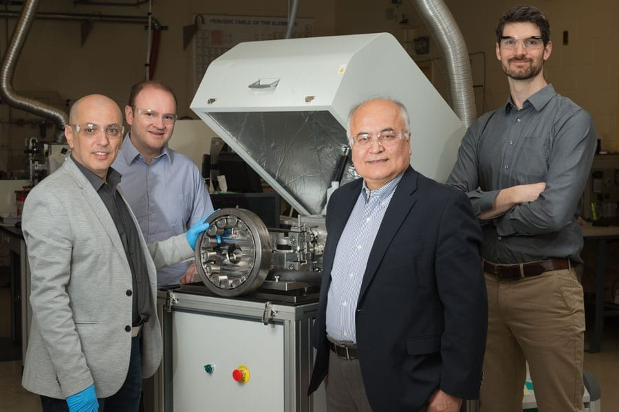 "Researchers from Argonne's Surface and Lubrication Interaction, Discovery and Engineering initiative developed a novel ""diamond-like"" coating that could prove of great benefit when used to coat equipment for wind turbines, like the bearing in this photo. Pictured from left, Levent Eryilmaz, Giovanni Ramirez, Ali Erdemir and Aaron Greco."