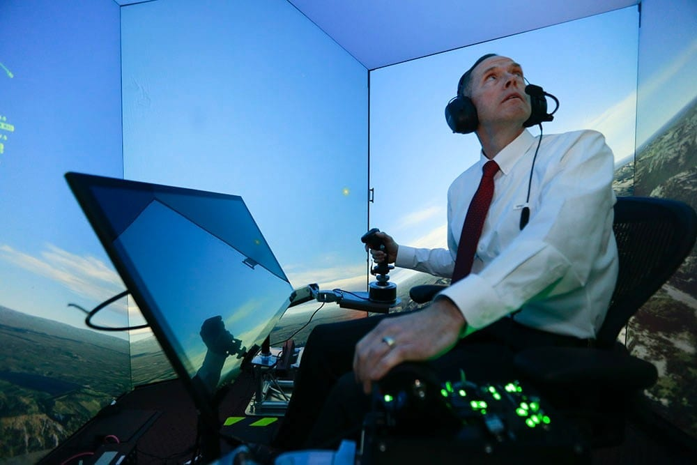 Retired United States Air Force Colonel Gene Lee, in a flight simulator, takes part in simulated air combat versus artificial intelligence technology developed by a team comprised of industry, U.S. Air Force and University of Cincinnati representatives.*