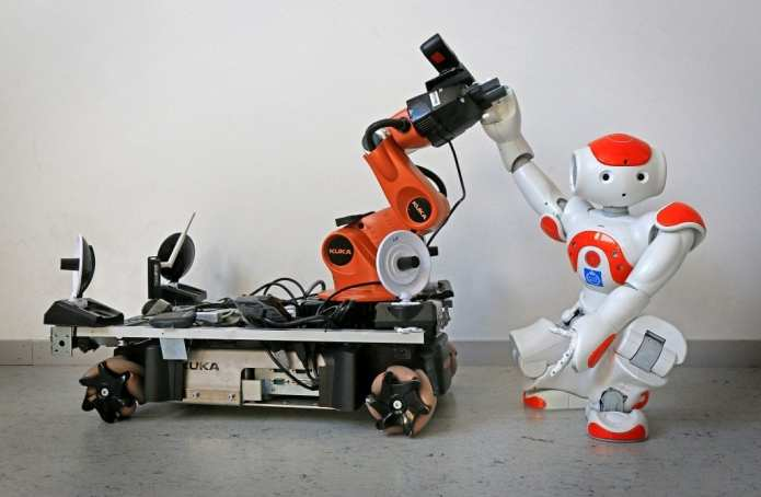 "Two off-the-shelf robots were used to demonstrate how robots can pick up each other's signals for assistance, and even set aside their own tasks in order to lend a ""hand""."