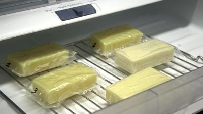 Researchers tested their milk-protein film as a packaging for blocks of cheese. CREDIT American Chemical Society