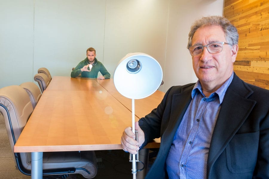 Argonne scientists Ivan Sadovskyy (left) and Valerii Vinokur published a paper showing a mathematical construction to a possible local violation of the Second Law of the Thermodynamics. One implication for the research could be a way to one day remotely power a device — that is, the energy expended to light the lamp could take place anywhere. (Image by Mark Lopez/Argonne National Laboratory.)