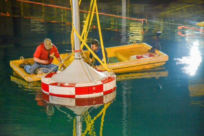 Sandia National Laboratories research engineers Ryan Coe and Giorgio Bacelli are collecting new information to optimize wave energy converter testing. (Photo courtesy of Sandia National Laboratories)