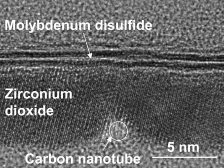 Transmission electron microscope image of a cross section of the transistor. It shows the 1-nanometer carbon nanotube gate and the molybdenum disulfide semiconductor separated by zirconium dioxide, an insulator. (Credit: Qingxiao Wang/UT Dallas)