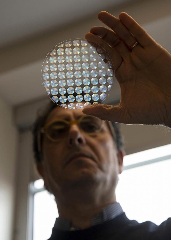 Giuseppe Strangi views a metalens array