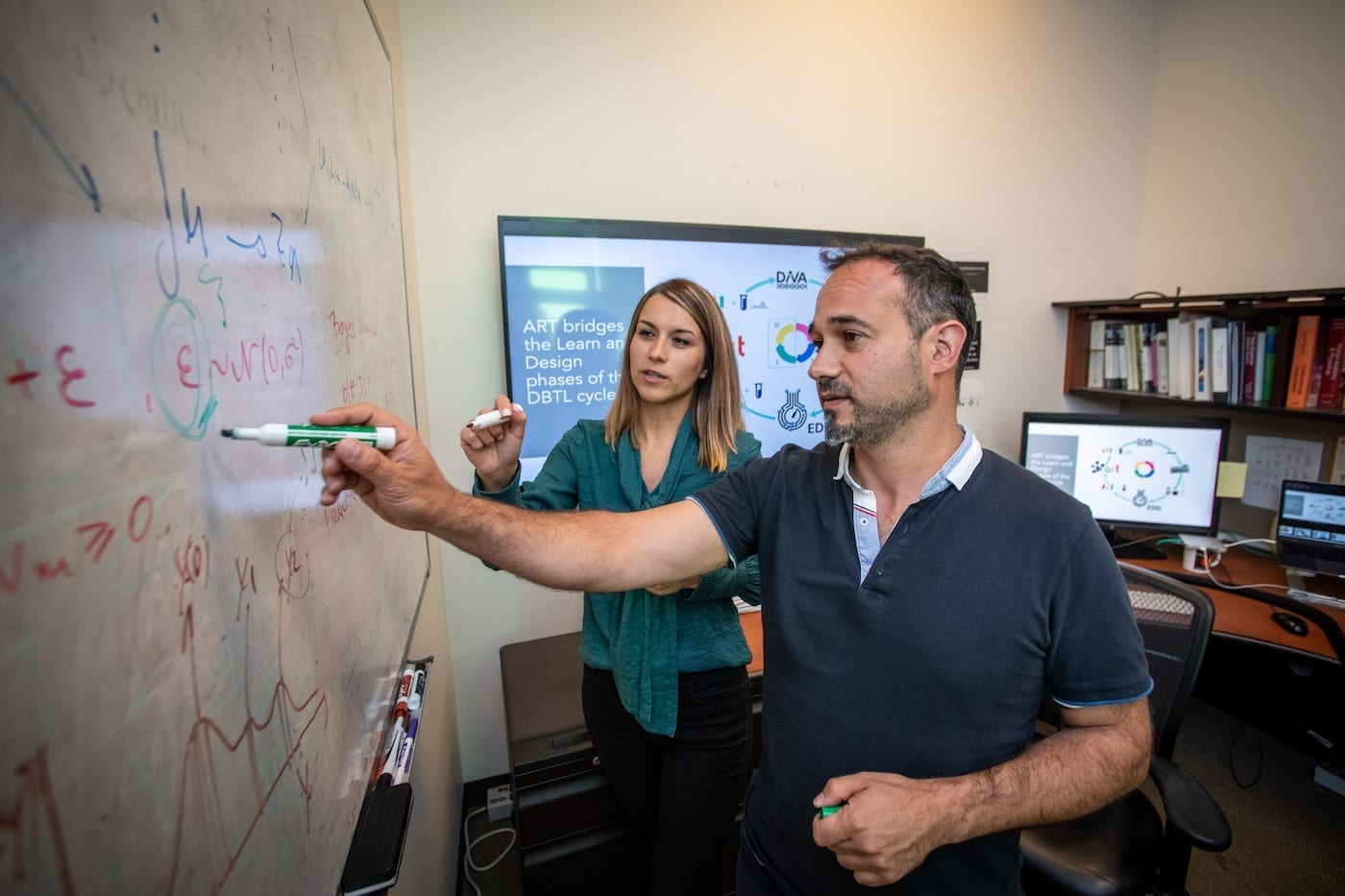 Tijana Radivojevic (left) and Hector Garcia Martin work on mechanical and statistical modeling, data visualizations and metabolic maps at the Agile BioFoundry. 08/09/2019, Emeryville, California