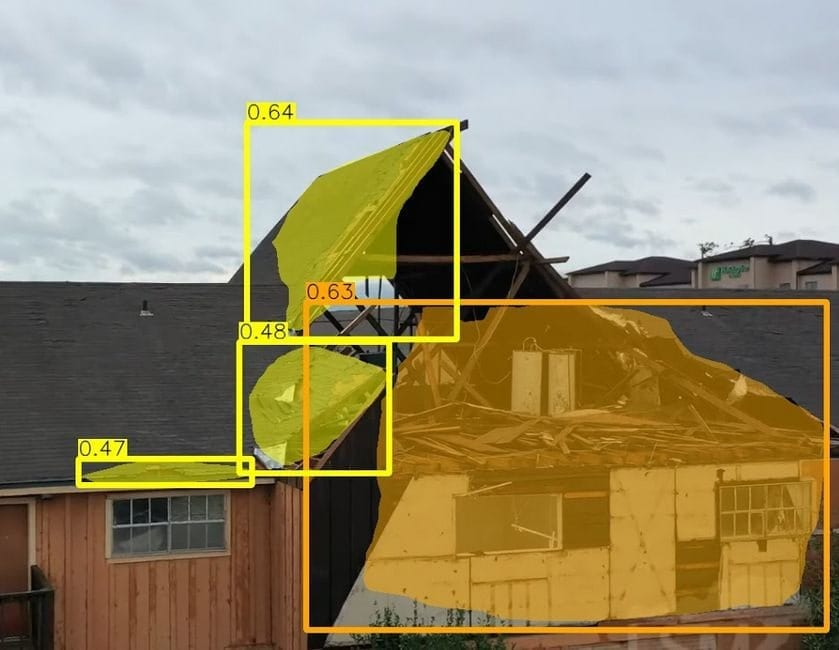A team of CMU researchers are using AI to develop a system that automatically identifies buildings in drone footage of natural disasters and determines if they're damaged. The system can identify if the damage is slight (yellow) or serious (orange) or if the building has been destroyed.