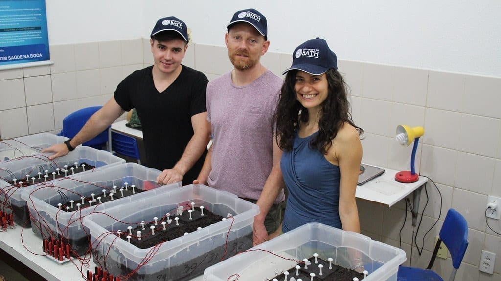 Bath researchers Jakub Dziegielowski, Dr Jannis Wenk and Dr Mirella Di Lorenzo testing Soil Microbial Fuel Cells in Brazil