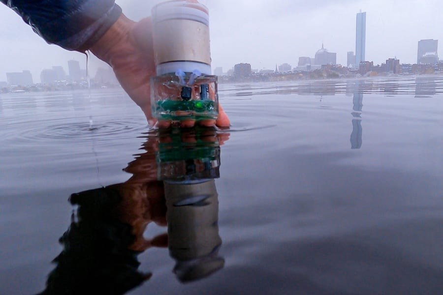 MIT researchers have built a battery-free pinpointing system dubbed Underwater Backscatter Localization (UBL). This photo shows the battery-free sensor encapsulated in a polymer before it is dipped into the Charles river. Image: Reza Ghaffarivardavagh
