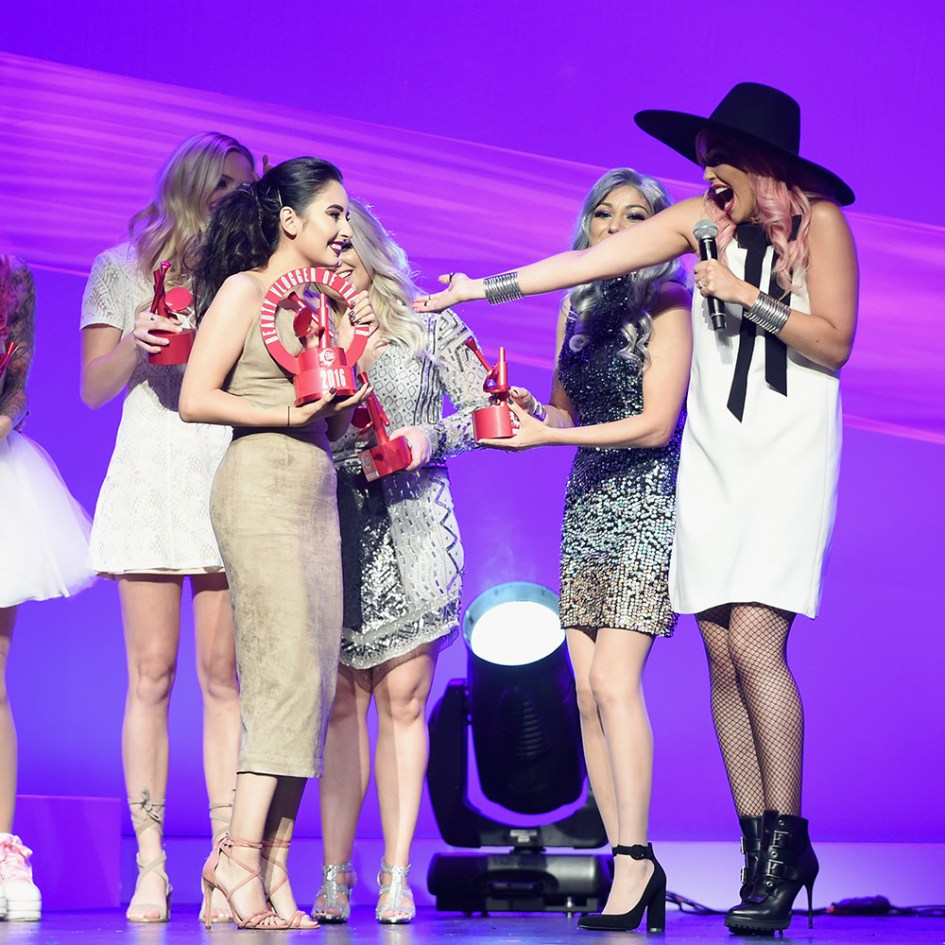 LOS ANGELES, CA - AUGUST 20: Finalist Laura Sanchez accepts the Beauty Vlogger of the Year award from influencer Charisma Star and host Kandee Johnson onstage during the 5th Annual NYX FACE Awards on August 20, 2016 in Los Angeles, California.  (Photo by Emma McIntyre/Getty Images for NYX Professional Makeup)