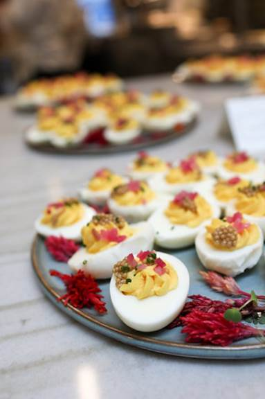 Guests enjoyed Oeufs Farcis, deviled eggs topped with mustard seeds, paprika and chives