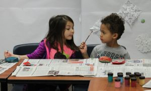 early learning children painting in ECEAP classroom