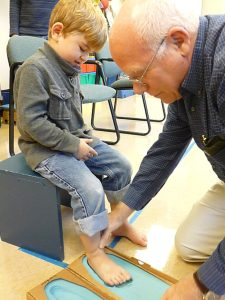 Child being fitted for orthotics in the orthotics clinic