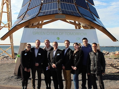 InnoVentum team near wind-solar power station Giraffe 2.0 on a wooden construction