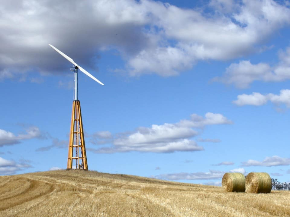 Dalifant small wind turbine 11 kW on a wooden tower on a farm field