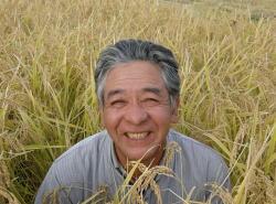 笑顔の石山範夫さん