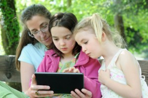 Apps for behavior management and intervention - Mom and girls on iPad
