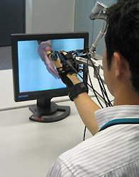 Sistema de visualização 3D com sensação de tato