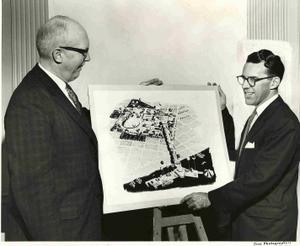 Century 21 Commission In a 1958 publicity photo, Eddie Carlson (on the right) looking at a fair concept that would have had the fair grounds (now Seattle Center) linked to the waterfront and a cruise ship dock. Yeosu did what Seattle thought about.