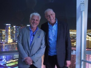 Phil Hettema(R) on one of his newest attractions, the High Roller observation wheel in Las Vegas, with John Kasperowicz (L)