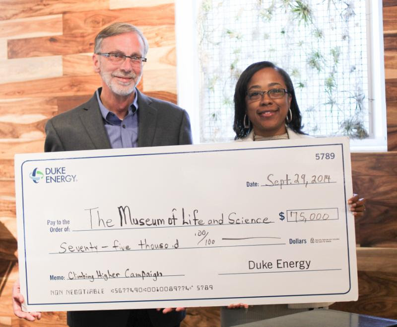(From l to r) Barry Van Deman, president and CEO of the Museum of Life and Science accepted the generous gift of Duke Energy Foundation to support Hideaway Woods, an outdoor learning environment opening summer 2015 at the Museum of Life and Science. Gift presented on behalf of Duke Energy Foundation by Indira Everett, district Manager of Government and Community Relations for Duke Energy.  Photo courtesy of the Museum of Life and Science