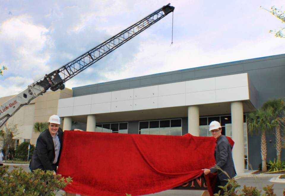 Michael Haimson and George Walker prepare to raise the sign on Dynamic Attractions' new Development Center in Orlando. All images courtesy of Dynamic Attractions