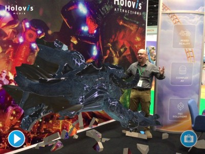 At Holovis' booth, IPM Editor Martin Palicki gets attacked by a virtual creature during a demonstration of the company's Augmented Reality system.