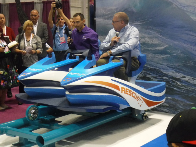 Mike Denninger and Carl Lum, President of SeaWorld San Antonio try out Wave Breaker's car.
