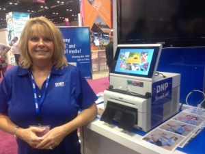 DNP's Suzanne Seagle stands next to the SnapLab+