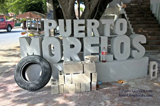 Another Puerto Morelos sign. You will never forget the name of the town again. I assume the old tire is not part of the project.