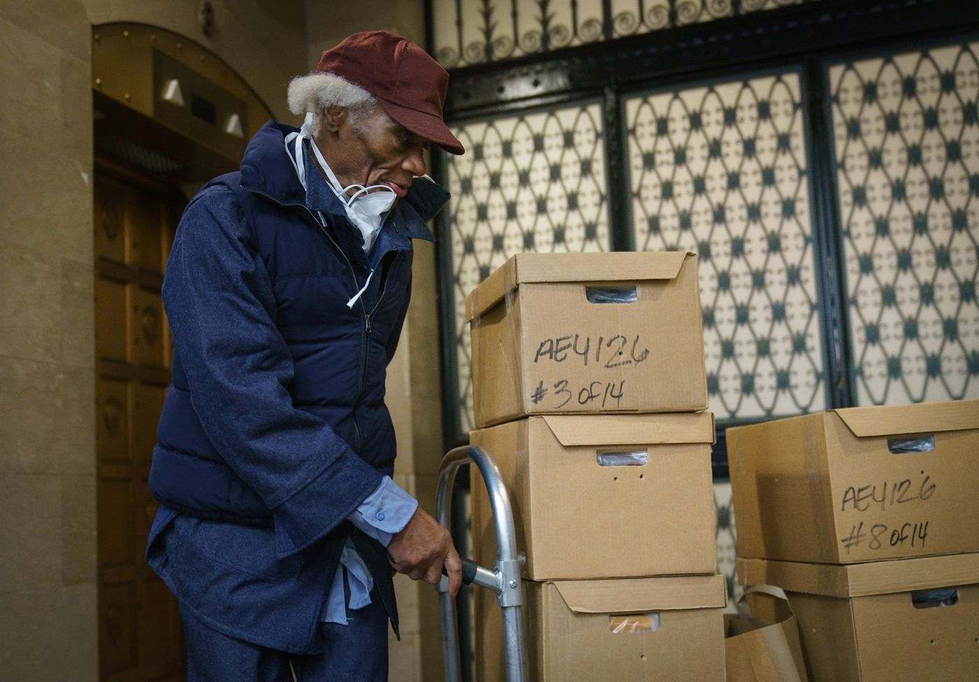 Joe Ligon brings boxes of legal documents to be stored at his lawyer's office after his release from prison after 68 years.