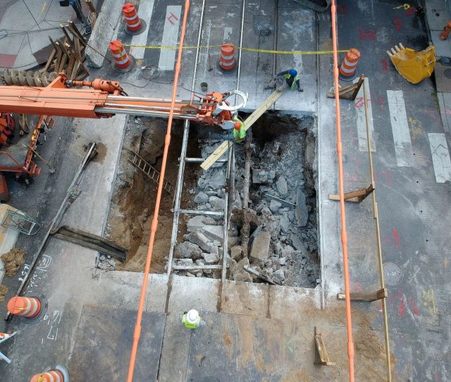 Workmen Remove The Trolley Tracks That Remained Over The Sinkhole At The Intersection Of 43rd And