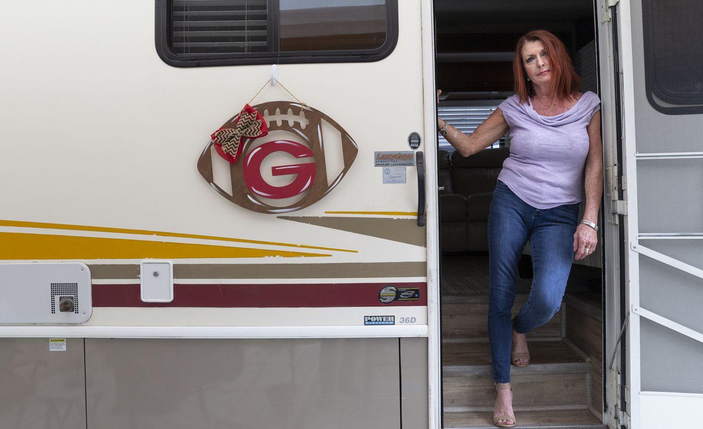 Tonya Osborne in the doorway of her RV. (Photo/Willie J. Allen Jr.)