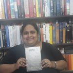 Fiza Pathan posing with the book Disciples by Austin Wright