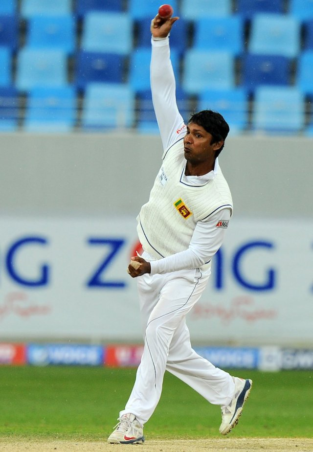 Sri Lankan bowler Kumar Sangakkara delivers a ball during the fourth day of the second cricket Test match between Pakistan and Sri Lanka at the Dubai International Cricket Stadium in Dubai on January 11, 2014. AFP PHOTO/Ishara S. KODIKARA (Photo credit should read Ishara S.KODIKARA/AFP/Getty Images)