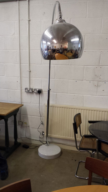 Chrome floor lamp designed to hang over a dining table