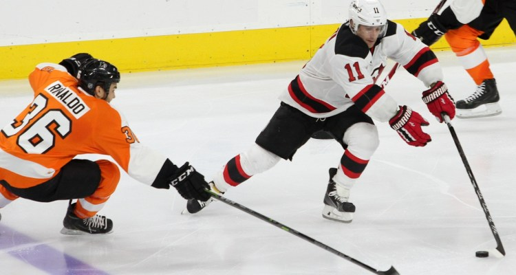 Center Stephen Gionta (#11) of the New Jersey Devils skates around Center Zac Rinaldo (#36) of the Philadelphia Flyers