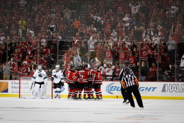 The New Jersey Devils celebrate a goal in the 3rd period against the San Jose Sharks in a game on October 18, 2014 at the Prudential Center in Newark, NJ.