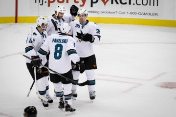The San Jose Sharks celebrate a goal in the 1st Period of their game against the New Jersey Devils on October 18, 2014 at the Prudential Center in Newark, NJ.