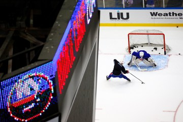 Taylor Cammarata dangles in front of Anthony Pupplo.(Brandon Titus/Inside Hockey)