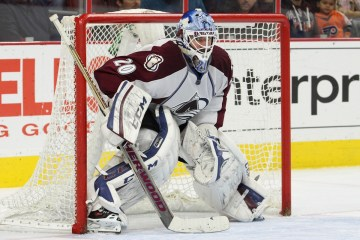 Goalie Reto Berra (#20) of the Colorado Avalanche protects the net