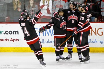 Austin Ortega (UNO - 16) celebrates his goal with teammates Dominic Zombo (UNO - 14), Joel Messner (UNO - 5), and Brian O'Rourke (UNO - 28).