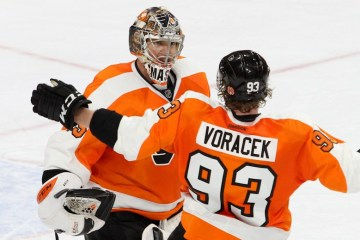 Right Wing Jakub Voracek (#93) of the Philadelphia Flyers congratulates Goalie Steve Mason (#35) of the Philadelphia Flyers