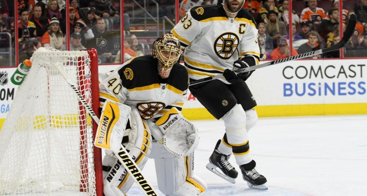 Goalie Tuukka Rask (#40) and Defenseman Zdeno Chara (#33) of the Boston Bruins keep their eyes on the puck