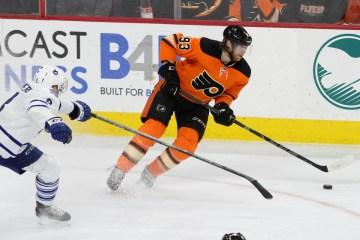 Right Wing Jakub Voracek (#93) of the Philadelphia Flyers avoids the stick of Defenseman Petter Granberg (#8) of the Toronto Maple Leafs
