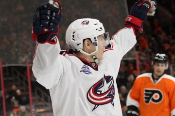 Left Wing Matt Calvert (#11) of the Columbus Blue Jackets raises his arms to celebrate his goal