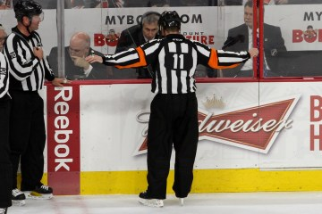 Referee Kelly Sutherland (#11) waves off a goal scored by the Buffalo Sabres