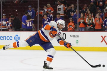Center John Tavares (#91) of the New York Islanders shoots the puck