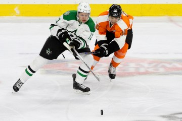 Center Brayden Schenn (#10) of the Philadelphia Flyers back-checks Center Mattias Janmark (#13) of the Dallas Stars during the first period
